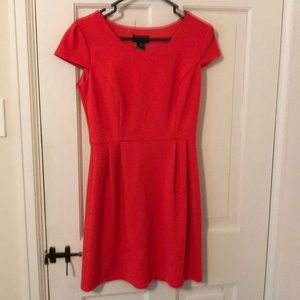 Pink/Orange dress and has never been worn.